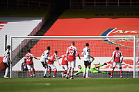 Football - 2020 /2021 Premier League - Arsenal v Fulham - Emirate Stadium<br /> <br /> Fulham's Alphonse Areola saves from Arsenal's Dani Ceballos but Eddie Nketiah (hidden) follows up to equalise .<br /> <br /> COLORSPORT