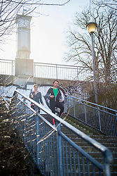 Man and woman jogging down stairs