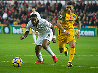 Football - 2017 / 2018 Premier League - Swansea City vs. Brighton & Hove Albion<br /> <br /> Leroy Fer of Swansea City attacks challenged by Anthony Knockaert of Brighton and Hove Albion, at The Liberty Stadium.<br /> <br /> COLORSPORT/WINSTON BYNORTH