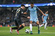 Gaël Clichy (Manchester City) tries to stop Patrick Roberts (Celtic) from getting into the penalty box during the Champions League match between Manchester City and Celtic at the Etihad Stadium, Manchester, England on 6 December 2016. Photo by Mark P Doherty.