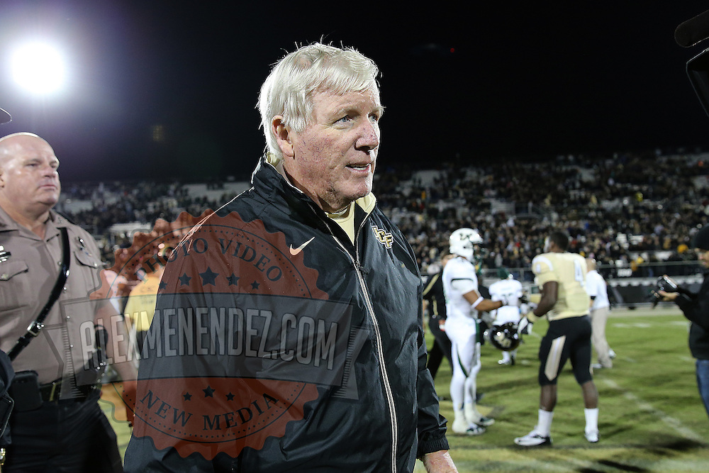 UCF head football coach George O'Leary walks off the field after defeating the South Florida Bulls by a score on 23-20 at Bright House Networks Stadium on Friday, November 29, 2013 in Orlando, Florida. (AP Photo/Alex Menendez)