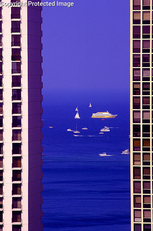 Looking at Lake Michigan framed by 2 condo towers in the Gold Coast