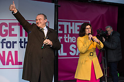 London, UK. 19 October, 2019. Layla Moran, Liberal Democrat MP for Oxford West and Abingdon, seen here with Deputy Leader of the Liberal Democrats Sir Ed Davey, addresses hundreds of thousands of pro-EU citizens at a Together for the Final Say People's Vote rally in Parliament Square as MPs meet in a 'super Saturday' Commons session, the first such sitting since the Falklands conflict, to vote, subject to the Sir Oliver Letwin amendment, on the Brexit deal negotiated by Prime Minister Boris Johnson with the European Union.