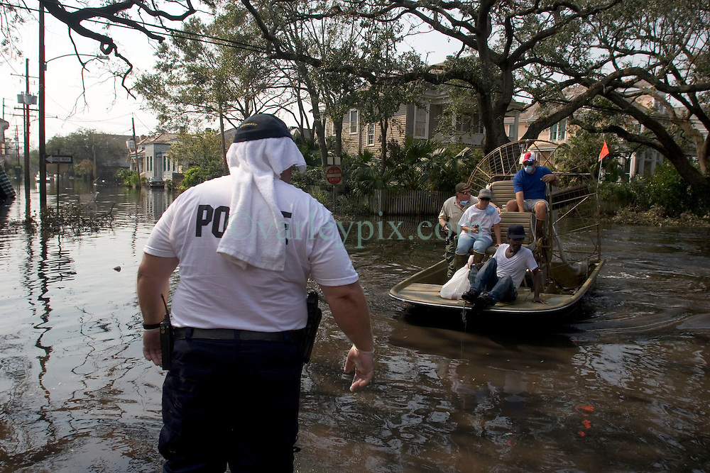 05 Sept  2005. New Orleans, Louisiana. Post hurricane Katrina.<br /> Some of the last evacuees are removed from Napolean Ave in Uptown New Orleans aboard airboats in the ghost town that once was New Orleans.<br /> Photo; ©Charlie Varley/varleypix.com