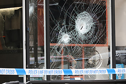 © Licensed to London News Pictures. 28/05/2019. London, UK. The scene outside the Hour House luxury shop in Duke Street in London's west end. Police were called at 10:30 to the shop dealing in luxury watches and clocks after reports that a moped gang had carried out a 'smash and grab' robbery in broad daylight. A number of males drove their mopeds into the store before making off. No arrests have been made. Photo credit: Rob Pinney/LNP