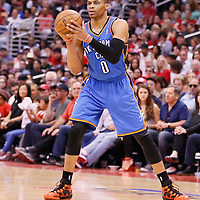 11 May 2014: Oklahoma City Thunder guard Russell Westbrook (0) looks to pass the ball during the Los Angeles Clippers 101-99 victory over the Oklahoma City Thunder, during Game Four of the Western Conference Semifinals of the NBA Playoffs, at the Staples Center, Los Angeles, California, USA.