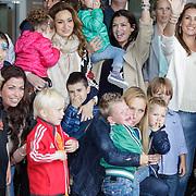 NLD/Amsterdam/20120604 - Vertrek Nederlands Elftal voor EK 2012, Bouchra van Persie en dochter Dina Layla, rechts Sabia Boulahrouz