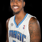 Kris Joseph poses in front of a backdrop during the Orlando Magic media day event at the Amway Arena on Monday, September 30, 2103 in Orlando, Florida. (AP Photo/Alex Menendez)