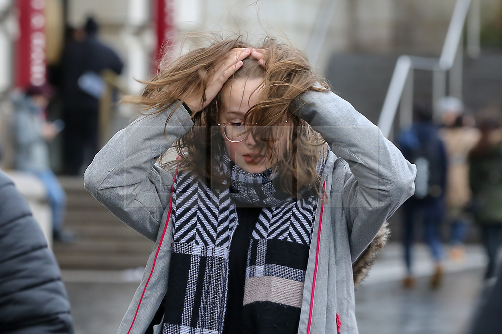 © Licensed to London News Pictures. 09/02/2020. London, UK. A woman braves the strong winds and blustery conditions on Westminster Bridge from Storm Ciara. Heavy rain and strong winds are forecast for the rest of today as the Storm Ciara sweeps across the UK. Photo credit: Dinendra Haria/LNP