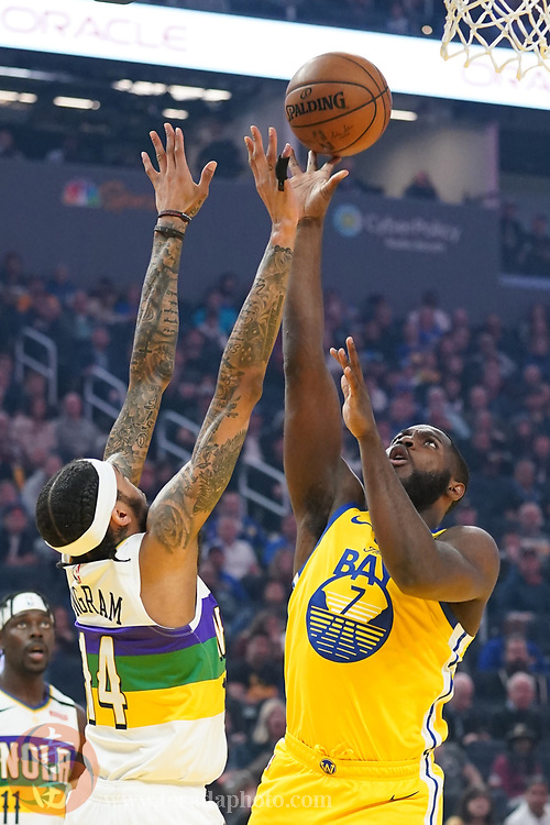 February 23, 2020; San Francisco, California, USA; Golden State Warriors forward Eric Paschall (7) shoots the basketball against New Orleans Pelicans forward Brandon Ingram (14) during the first quarter at Chase Center.