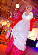 Stilt walker Deb Ervin walks through the crowd during Minneapolis Mayor Betsy Hodges' inauguration party at the historic Thorp Building in Northeast Minneapolis, Saturday, January 11, 2014.