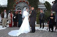 """NEW YORK, NY.   Bride Jennifer Stesanki and groom Al Villarante during their wedding ceremony at Tavern on the Green in Central Park, NY on Tuesday, December 28, 2004.  Quote from the groom's brother, Ariel: """"Wishing them lifelong memories and success. To enjoy their lives together and to make it all last.""""  (Photograph by Chet Gordon for The New York Daily News)"""