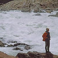 Explorer beside rapids in one of world's remotest and deepest gorges.