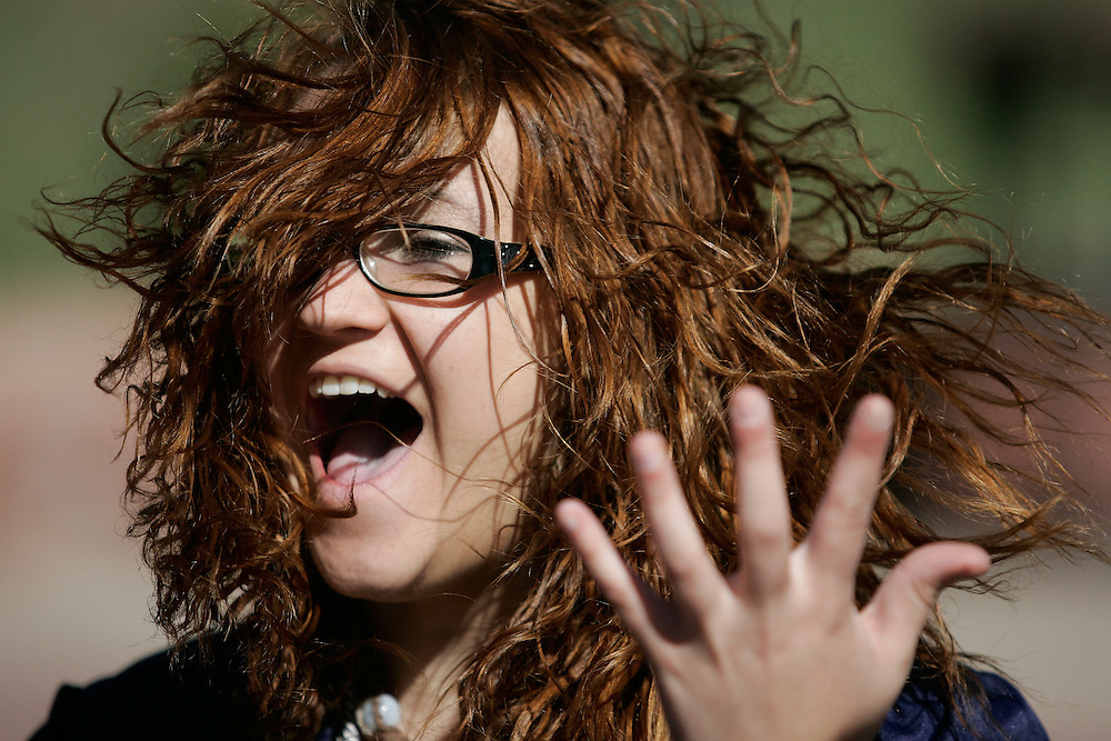 052210-Morrison, Colorado-ehsgrads-Evergreen High School graduate Sarah Tutchton reacts to a wind gust while waiting to take the stage for graduation ceremonies Saturday, May 22, 2010 at Red Rocks Amphitheater in Morrison..Photo By Matthew Jonas/Evergreen Newspapers/Photo Editor