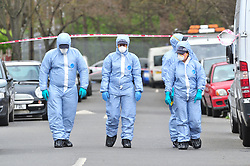 © Licensed to London News Pictures.04/04/2018<br /> HITHER GREEN, UK.<br /> Police forensic search team on Further Green Road.<br /> 78 year old man arrested in Hither Green, London after a  burgarly death. police on scene.<br /> Photo credit: Grant Falvey/LNP