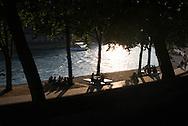 France. Paris. 4th district. Seine river quay des Celestins.  . people sunbathing   on right bank quays.   / bain de soleil sur le quai des Celestins