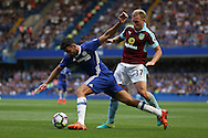 Scott Arfield of Burnley challenges Diego Costa of Chelsea. Premier league match, Chelsea v Burnley at Stamford Bridge in London on Saturday 27th August 2016.<br /> pic by John Patrick Fletcher, Andrew Orchard sports photography.