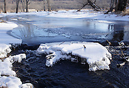 Chester, NY - Ice-covered Seely Brook flows through Goose Pond Mountain State Park on Jan. 9, 2010.