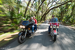 Danilo Dibierro (left) of Italy out for a ride with Melissa Shoemaker on Danilo's rented Harley-Davidson dresser and Warren Lane on his stock 1964 Panhead during Daytona Bike Week. FL, USA. March 14, 2014.  Photography ©2014 Michael Lichter.