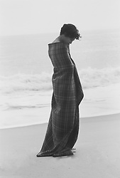 woman in a plaid blanket on the beach in East Hampton,NY