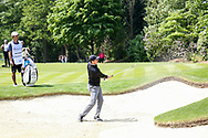 Rory Mcllroy chips out of the bunker during the Celebrity Pro-Am day at Wentworth Club, Virginia Water, United Kingdom on 23 May 2018. Picture by Phil Duncan.