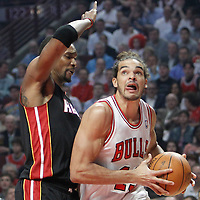 14 March 2012: Chicago Bulls center Joakim Noah (13) drives past Miami Heat power forward Chris Bosh (1) during the Chicago Bulls 106-102 victory over the Miami Heat at the United Center, Chicago, Illinois, USA.