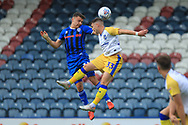 Ollie Rathbone wins an aerial duel during the EFL Sky Bet League 1 match between Rochdale and Gillingham at Spotland, Rochdale, England on 15 September 2018.