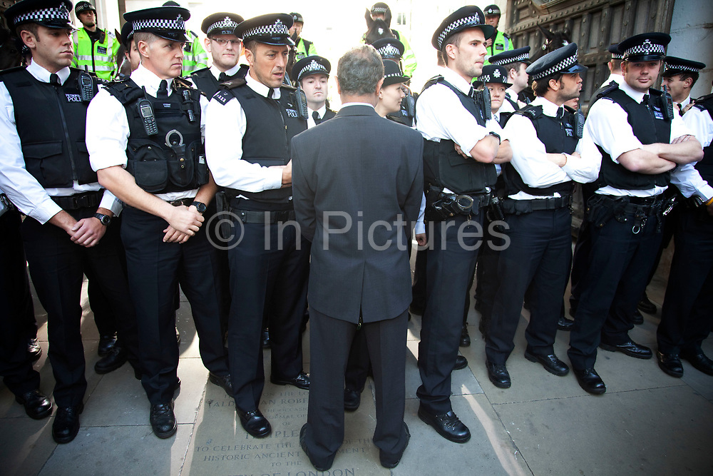 """Police lines blocking Paternoster Square. Occupy London protest, October 15th 2011. Protest spreads from the US with this demonstrations in London and other cities worldwide. The 'Occupy' movement is spreading via social media. After four weeks of focus on the Wall Street protest, the campaign against the global banking industry started in the UK this weekend, with the biggest event aiming to """"occupy"""" the London Stock Exchange. The protests have been organised on social media pages that between them have picked up more than 15,000 followers. Campaigners gathered outside  at midday before marching the short distance to Paternoster Square, home of the Stock Exchange and other banks.It is one of a series of events planned around the UK as part of a global day of action, with 800-plus protests promised so far worldwide.Paternoster Square is a private development, giving police more powers to not allow protesters or activists inside."""