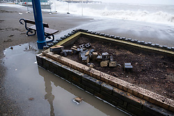 © London News Pictures. 04/01/2018. Aberystwyth, UK.   Damage caused to flower beds at the seafront at Aberystwyth by storm Eleanor. Strong westerly winds gusting over 75 mph whipped the high Spring Tide into huge waves yesterday, that batter the seafront at Aberystwyth on the Cardigan Bay coast of west Wales. Photo credit: Keith Morris/LNP