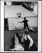 Sliding down the marquee during the New College May Ball. Oxford. 24 June 1983. film 83445f6<br /> © Copyright Photograph by Dafydd Jones<br /> 66 Stockwell Park Rd. London SW9 0DA<br /> Tel 0171 733 0108