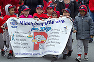Middletown, New York - Children and adults march in the 60th annual Middletown Little League parade on April 14, 2013.