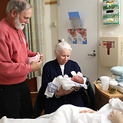Grand parents visit their daughter and newborn baby on the day of birth. Photo Tim Clayton