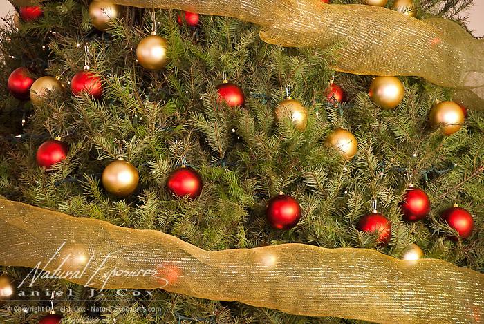 Glass bulb ornaments hang on a Christmas tree. Mexico.