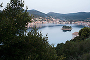 The small island of Lazaretto in the tranqil harbour of Vathy. Ithaca, Greece. This islet was converted into a prison in 1864 which fell in the earthquakes in 1953. The Greek island of Ithaca is situated in the Ionian Sea off the northeast coast of Kefalonia. Since antiquity, Ithaca has been identified as the home of the mythological hero Odysseus.