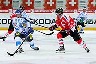 04.April 2012; Rapperswil-Jona; Eishockey - Schweiz - Finnland; Michael Liniger (R, SUI) gegen Juuso Hietanen (L, FIN)<br />  (Thomas Oswald)