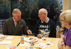 Prince Charles (known as The Duke of Rothesay when in Scotland, left) with patient Jim Fitzsimmons (right) taking part in a painting class during his visit to the Ayrshire Hospice in Ayr where he met patients and their families, staff and volunteers.