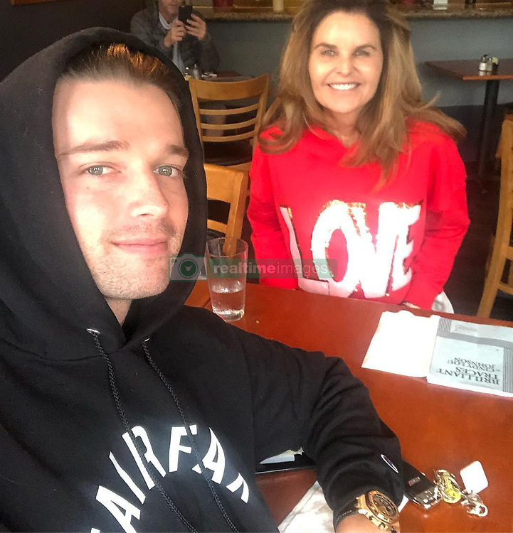 """Patrick Schwarzenegger releases a photo on Instagram with the following caption: """"Took Ma to lunch. Happy Valentine\u2019s Day! Love yah \u2764\ufe0f"""". Photo Credit: Instagram *** No USA Distribution *** For Editorial Use Only *** Not to be Published in Books or Photo Books ***  Please note: Fees charged by the agency are for the agency's services only, and do not, nor are they intended to, convey to the user any ownership of Copyright or License in the material. The agency does not claim any ownership including but not limited to Copyright or License in the attached material. By publishing this material you expressly agree to indemnify and to hold the agency and its directors, shareholders and employees harmless from any loss, claims, damages, demands, expenses (including legal fees), or any causes of action or allegation against the agency arising out of or connected in any way with publication of the material."""