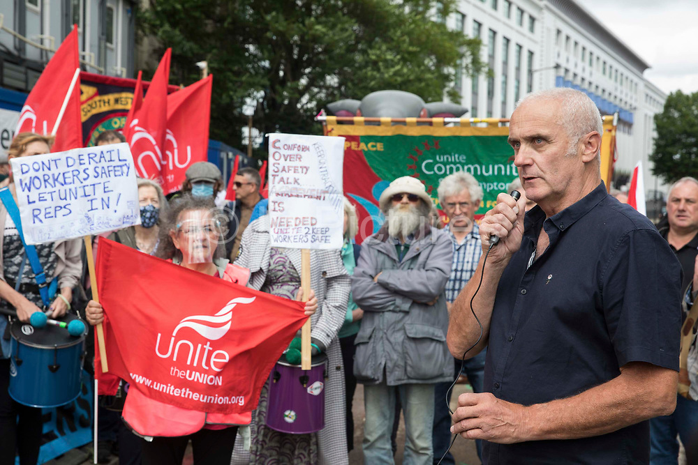 Bill Parry, Unite delegate and construction worker, addresses Unite the union members protesting outside the Euston construction site for the HS2 high-speed rail link regarding trade union access to construction workers building tunnel sections for the project on 6th August 2021 in London, United Kingdom. Unite claims that HS2s joint venture contractor SCS, formed by Skanska, Costain and Strabag, has been hindering meaningful trade union access to HS2 construction workers in contravention of the HS2 agreement.