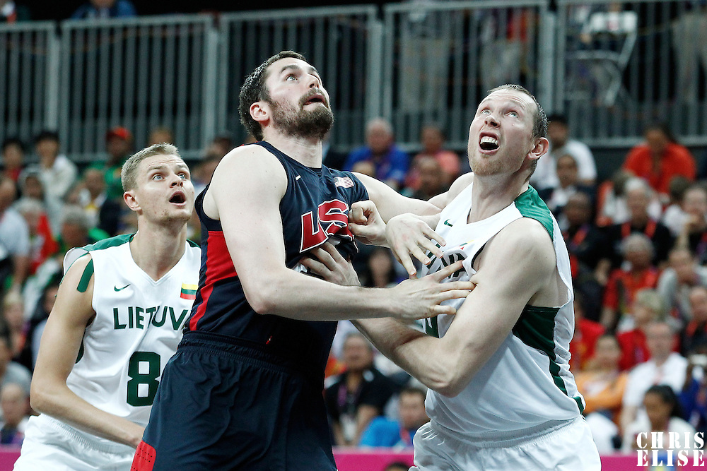 04 August 2012: USA Kevin Love vies for the rebound with Lithuania Darius Songaila and Renaldas Seibutis during 99-94 Team USA victory over Team Lithuania, during the men's basketball preliminary, at the Basketball Arena, in London, Great Britain.