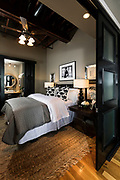 Bedroom in a styled loft photo by Brandon Alms Photography