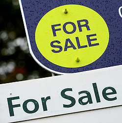 File photo dated 14/10/14 of property sale signs. House prices recorded their third monthly decrease in a row in May - the first time this has happened since 2009 - according to an index.