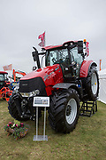A red Case IH 240 tractor at the Suffolk Show on the 29th May 2019 in Ipswich in the United Kingdom. The Suffolk Show is an annual show that takes place in Trinity Park, Ipswich in the English county of Suffolk. It is organised by the Suffolk Agricultural Association.