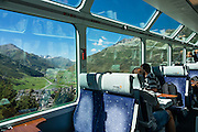 """Playfully, Switzerland advertises the Glacier Express as """"the slowest express train in the world."""" Opened in 1930, this narrow gauge railway connects the mountain resorts of Zermatt and St. Moritz in the Swiss Alps, from the Matterhorn to Piz Bernina, frequently applying a rack-and-pinion system to go up and down steep grades. An especially curlycue portion of the Glacier Express route is honored as a UNESCO World Heritage Site: the """"Rhaetian Railway in the Albula / Bernina Landscapes"""". Jointly operated by the Matterhorn Gotthard Bahn (MGB) and Rhaetian Railway (RhB), the 7.5 hour railway journey crosses 291 bridges, enters 91 tunnels and reaches 2033 m (6670 ft) elevation at Oberalp Pass."""