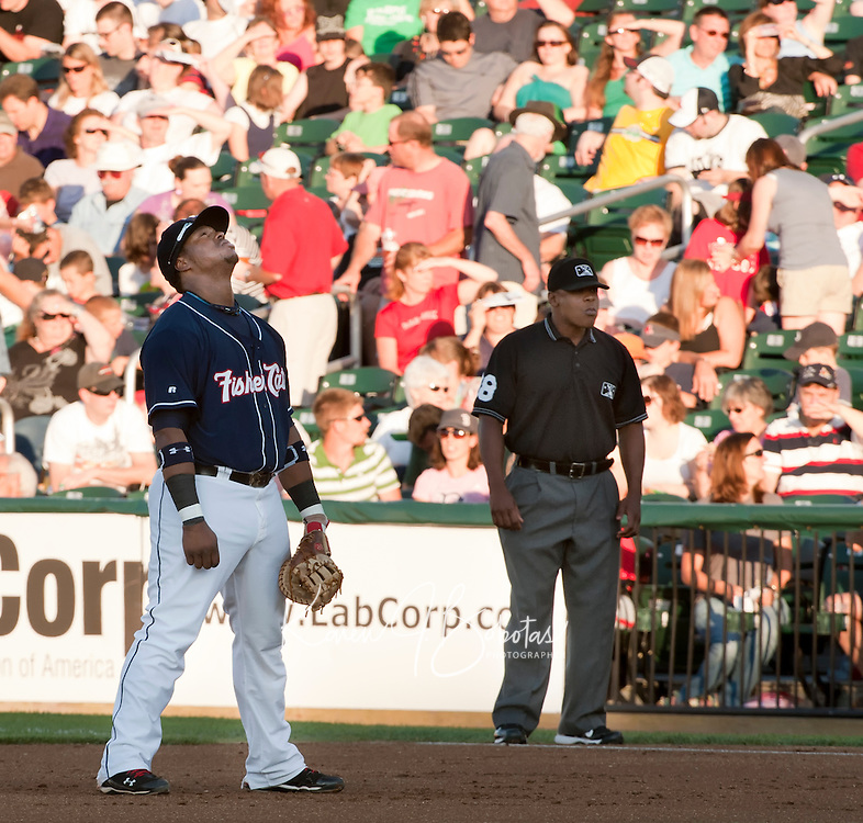 New Hampshire Fisher Cats first baseman Mike McDade takes a moment as he gets into position for Saturday's game with the Portland Sea Dogs.  (Karen Bobotas/for the Concord Monitor)