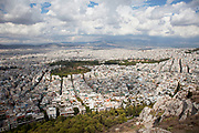 View across the sprawling city of Athens from the summit of Lykavittos Hill in the North Eastern section of the centre of the city. The spectacular views can be seen in all directions from this vantage point, giving aerial and panoramic views of the vast urban spread of buildings and humanity below. Athens is the capital and largest city of Greece. It dominates the Attica periphery and is one of the world's oldest cities, as its recorded history spans around 3,400 years. Classical Athens was a powerful city-state. A centre for the arts, learning and philosophy.