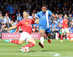 Crewe Alexandra's Harry Davis clears while under pressure from Peterborough United's Britt Assombalonga  - Photo mandatory by-line: Joe Dent/JMP - Tel: Mobile: 07966 386802 07/09/2013 - SPORT - FOOTBALL -  Alexandra Stadium - Crewe - Crewe Alexandra V Peterborough United - Sky Bet League One
