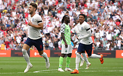 England's Gary Cahill (left) celebrates scoring his side's first goal of the game during the International Friendly match at Wembley Stadium, London.