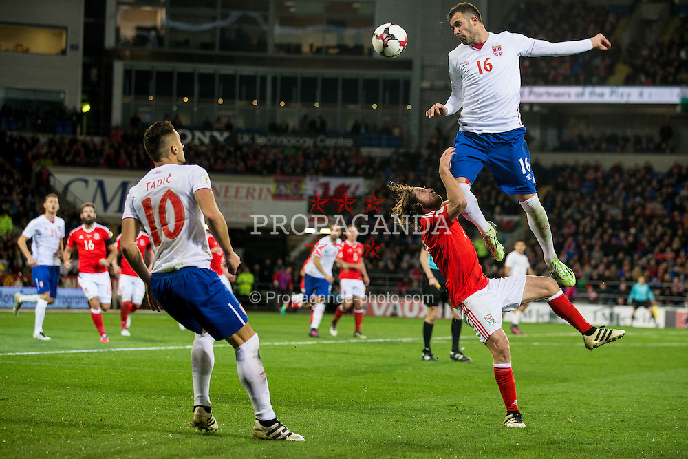 CARDIFF, WALES - Saturday, November 12, 2016: Wales' Joe Allen in action against Serbia's Luka Milivojević during the 2018 FIFA World Cup Qualifying Group D match at the Cardiff City Stadium. (Pic by David Rawcliffe/Propaganda)