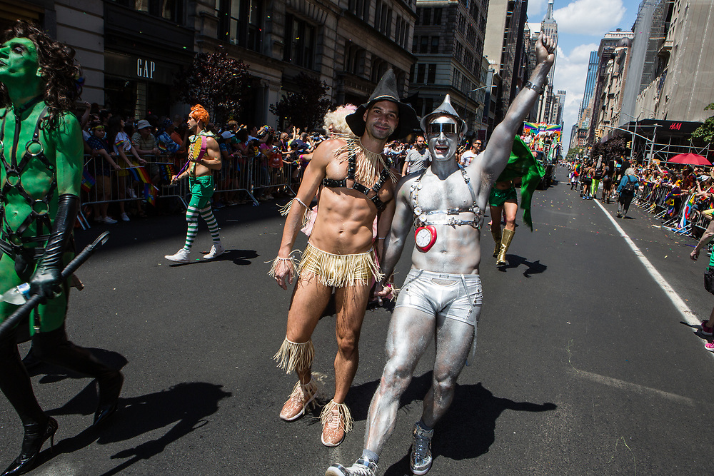 New York, NY - 30 June 2019. The New York City Heritage of Pride March filled Fifth Avenue for hours with participants from the LGBTQ community and it's supporters. Two men dressed as the Tin Woodsman and the Scarecrow from The Wizard of Oz.