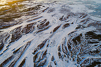 Frozen strings of water create an abstract pattern from above during Winter in Northern Utah.